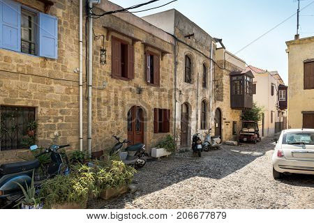 Street with old houses in Rhodes town on Rhodes island,  Greece