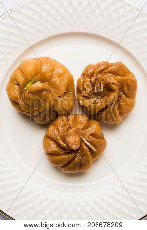 Stock photo of Balushah or balushaii, Indian sweet food made up of Maida floor, oil and sugar, selective focus