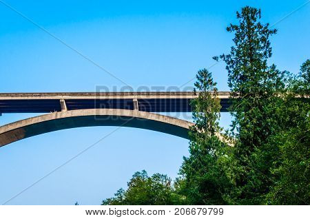 Scenic unique view of highway bridge extending over river.  Image taken from underneath to create and interesting vantage point of this beautiful structure.