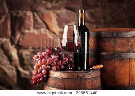 Red Wine.still Life With Glass And Bottle Of Red Wine, Grapes And Barrel.selective Focus.wine Cellar