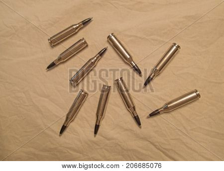 Gun ammunition on a cream colored background