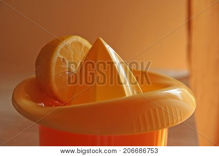 Lemon juicer. Manual lemon juicer. Lemon juice.