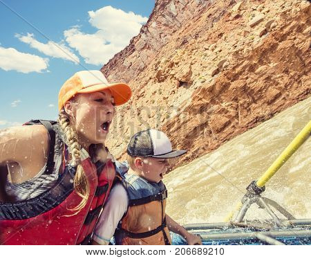 Family on an exciting rafting trip down the Colorado River