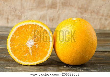 Fresh navel orange fruit on wooden background,healthy fruit