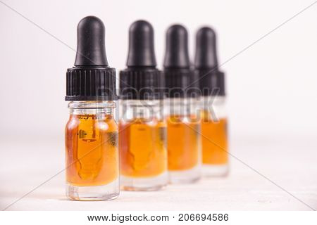 Macro detail of dropper with CBD oil, cannabis live resin extraction isolated on white - medical marijuana concept