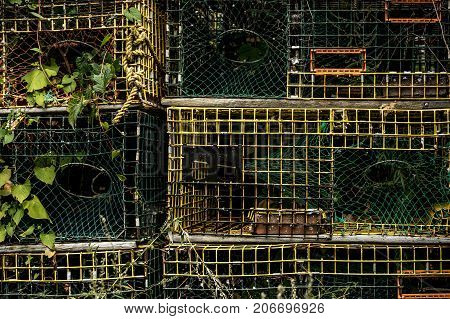Stacked lobster traps in new england fisherman fish