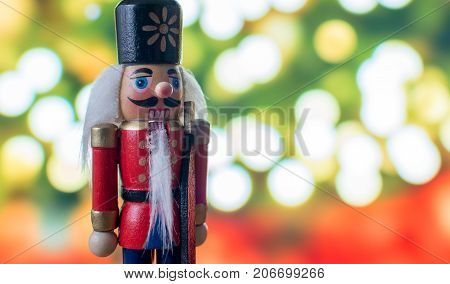 Christmas nutcracker toy soldier traditional figurine with bokeh background