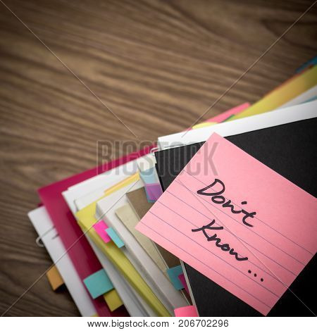 Do Not Know; The Pile Of Business Documents On The Desk