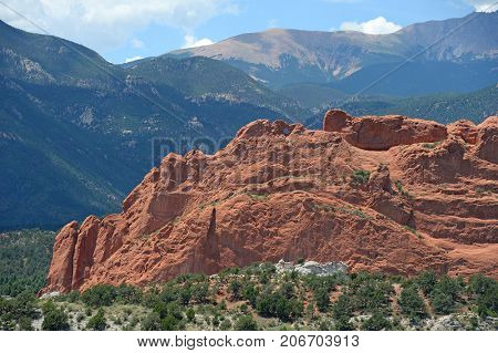 Garden of the Gods park in Colorado Springs with Pikes Peak in background