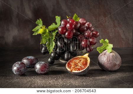 Still Life With Fruits: Grape, Fig, Plum In The Antique Copper Tin Cup
