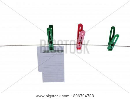 colored clothespins on rope isolated on white background for pruning