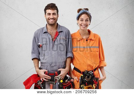 Team Of Technicians Work Together, Smile Positively As Find Out That Tommorow Is Weekend, Being Glad