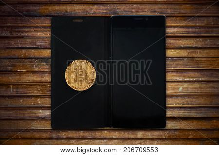 Gold Bitcoin Cryptocurrency With A Smartphone