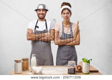 Upset Discontent Female Wears Apron, Has Dirty Face, Holds Rolling Pin, Spends All Weekends At Kitch