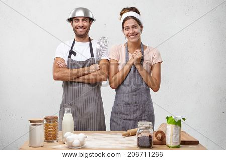 Positive Team Of Young Male And Female Cooks Smile Joyfully As Recieve Reward From Chef, Stand On Ki