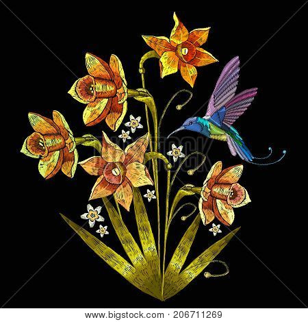 Embroidery humming bird and narcissus. Beautiful hummingbird and yellow narcissus embroidery on black background. Template for clothes textiles t-shirt design