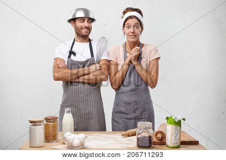 Indoor Shot Of Shocked Female Cook Doesn`t Believe Eyes And Ears, Hears That She Won Culinary Contes