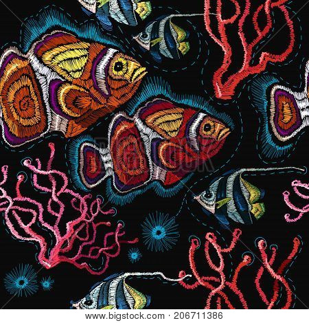 Embroidery sea life sea shells corals clown fish tropical fishes seamless pattern. Classical embroidery tropical sea wave fishes corals shells seamless fashion pattern. Fashionable clothes