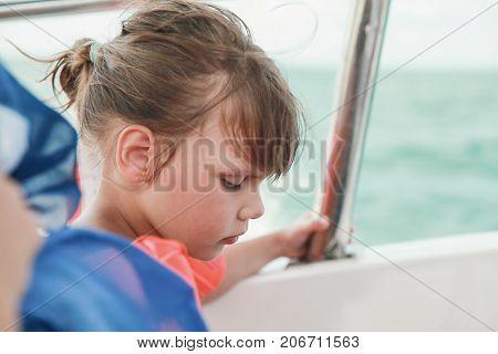 Llittle Girl In Life-jacket As Passenger Of Boat