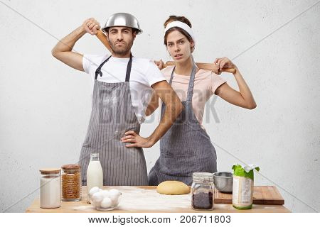 Confident Professional Cooks Wear Apron, Hold Rolling Pins Behind Backs, Work As Team, Ready To Take