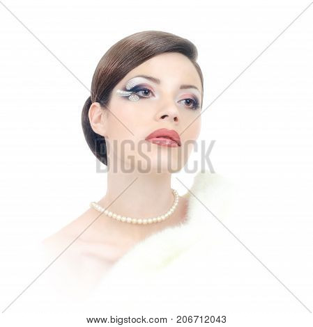 Elegant brunette lady with pearl neclace and stylish maquillage