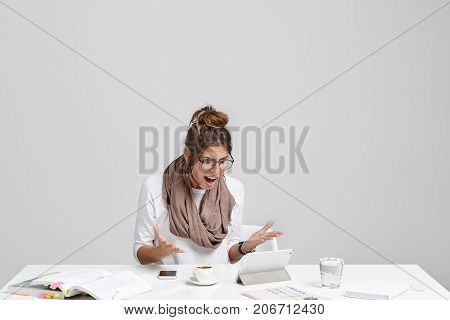 Troublesome Worried Young Female Has Problems During Work, Doesn`t Know How To Use Programm On Table