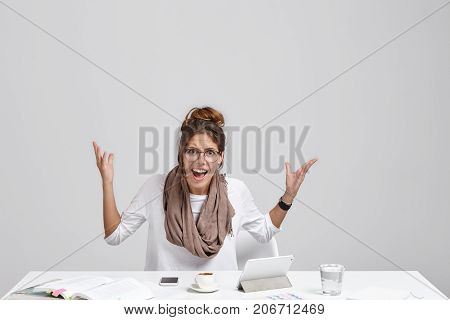 Isolated Portrait Of Annoyed Unhappy Young Female Entrepreneur Dressed In Casual Clothes Gesturing A