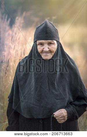 portrait of a nun in the background of nature