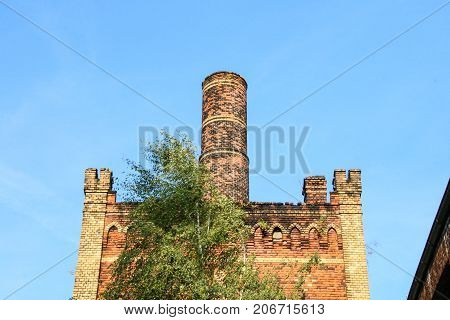 MAGDEBURG, GERMANY - September 29, 2017: Old industrial building with chimney.