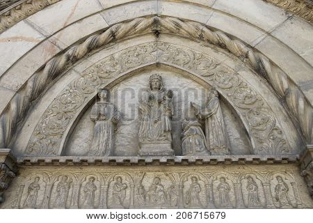 Part of religious sculptural composition above entrance to chapel in medieval castle. Grazzano Visconti Italy