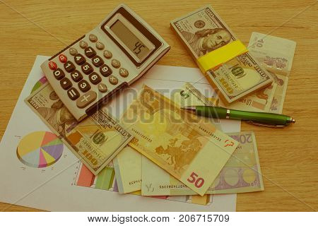 Currency exchange concept. finances currency exchange rate and business concept. money with calculator on the wooden table - Retro color