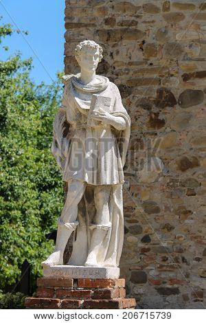 Marble statue of St. Damian at the entrance to the parish of Cosmas and Domian Grazzano Visconti Italy