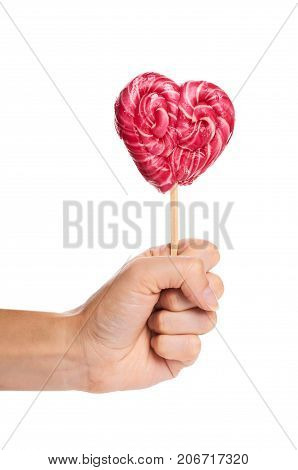 Hand Made Candy Heart Shape In Hand Isolated On White Background