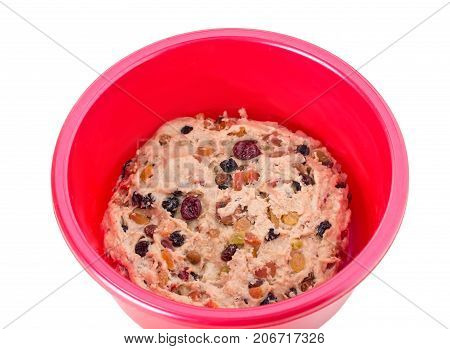 Dough for pie with dried fruits.  Isolated on a white background.
