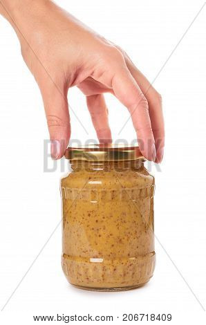 Home Made Mustard In Glass Bottle In Hand Isolated On White Background