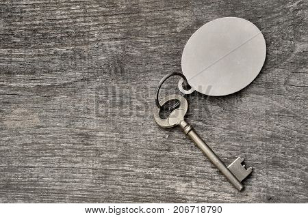 old key on a ring on wooden background