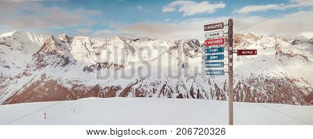 Chamonix, France - January 22, 2015: Signpost to ski slopes at alpine skiing areas in French Alps, Chamonix, Le Tour