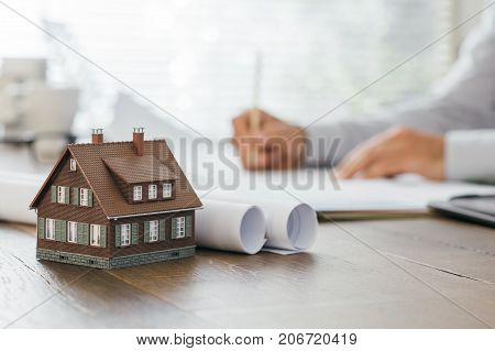 Architect Working At Office Desk