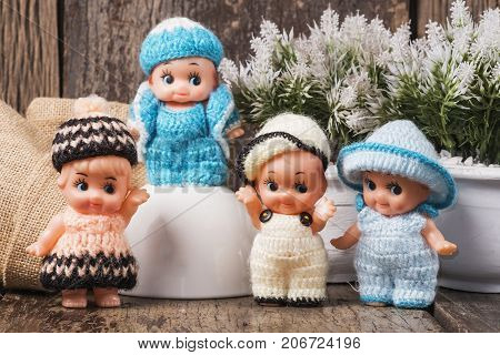 Cute baby dolls for decoration on wood table