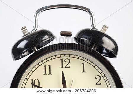 Analog clock telling time on white background
