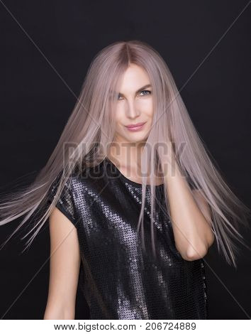 Photo of young beautiful woman with magnificent purple hair