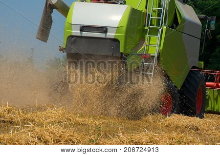 Combine harvester from close up during harvest . Harvesting of wheat.
