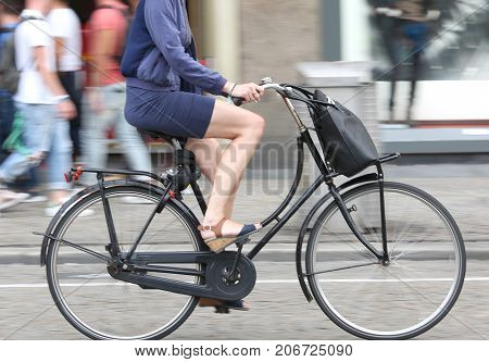 Long Legs Of Woman While Pedal On Bicycle And The Background Int
