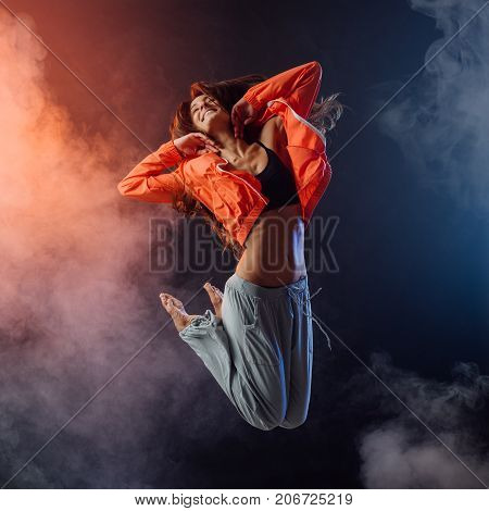 Performer Dancing On Dark Background