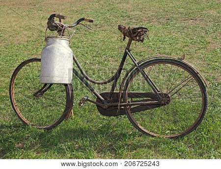 Old Milking Bicycle With Aluminum Milk Canister To Deliver Milk