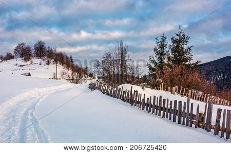 Snowy Path Through Rural Area In Mountains