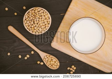 Glass With Soy Milk And Soy Bean On Wooden Background
