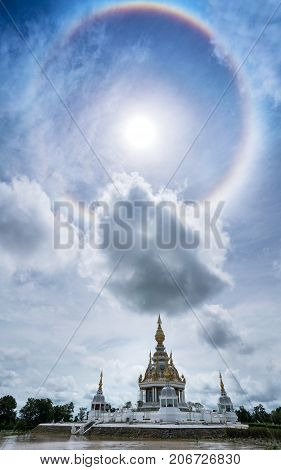 Magnificent Wat Thung Setthi (The Great Jewel Chedi of the three worlds) with amazing sun halo Khon Kaen thailand poster