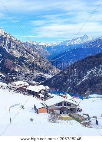 Winter ski resort Courmayeur aerial view, Italian Alps. Mountains, restaurants, ski lift and cable car station