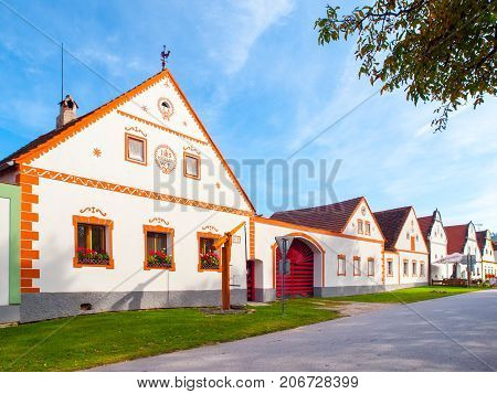 Picturesque houses of Holasovice, small rural village with rustic baroque architecture. Southern Bohemia, Czech Republic. UNESCO heritage site.